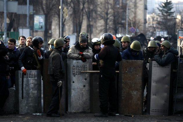 anti-government-protesters-man-a-barricade-on-the-outskirts-of-independence-square-in-kiev-ukraine-on-friday-in-a-day-that-could-significantly-shift-ukraines-political-destiny-opposition-leaders-signed-a-deal-friday-with-the-countrys-beleaguered-president-that-calls-for-early-elections-a-new-constitution-and-a-new-unity-government