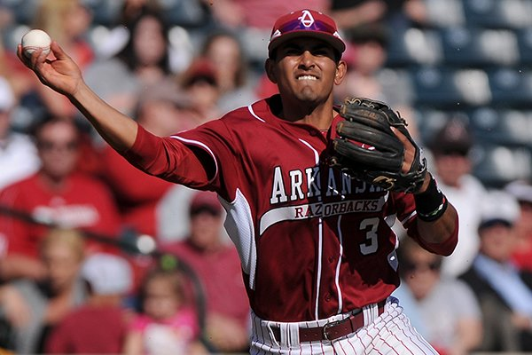 Arkansas shortstop Michael Bernal throws to first after fielding a ground ball during the game against Eastern Illinois at Baum Stadium in Fayetteville on Saturday, Feb. 22, 2014.
