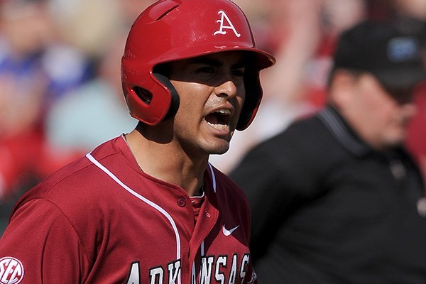 Arkansas third baseman Michael Bernal celebrates after scoring a run during the game against Eastern Illinois at Baum Stadium in Fayetteville on Saturday, Feb. 22, 2014.