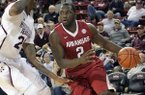 Arkansas' Alandise Harris (2) drives past Mississippi State's Roquez Johnson, left, during the first half of an NCAA college basketball game in Starkville, Miss., Saturday, Feb. 22, 2014. (AP Photo/Jim Lytle)