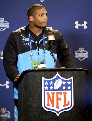 Missouri defensive end Michael Sam told members of the media at the NFL Scouting Combine that he wants to be recognized for his ability as a football player, not because of his sexuality.