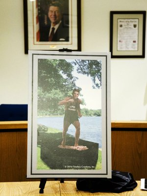 This is an artist's rendering of what Dixon, Ill., officials want to turn into a 7-foot bronze statue of young lifeguard Ronald Reagan rushing to the rescue at the city's Lowell Park.