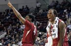 Arkansas' Coty Clarke (4) and Michael Qualls, right, celebrate during the second half of an NCAA college basketball game against Mississippi State in Starkville, Miss., Saturday, Feb. 22, 2014. (AP Photo/Jim Lytle)