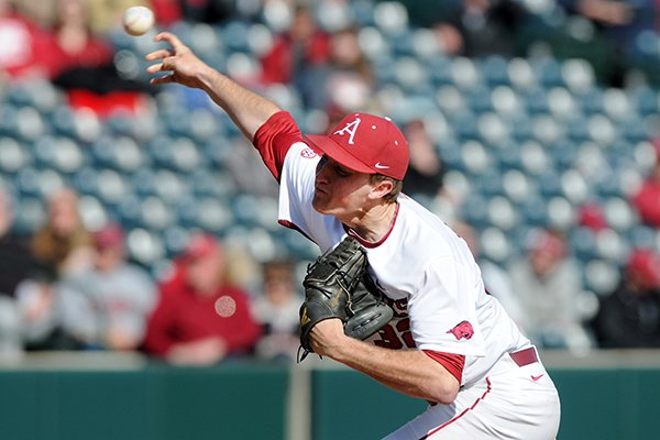 Arkansas' Zach Jackson releases the ball Sunday, Feb. 23, 2014, during the last of a three-game series against Eastern Illinois at Baum Stadium in Fayetteville.