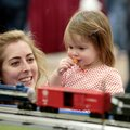 Jill Fulks (cq) and her daughter, Alivia (cq) Fulks, 1, both of Fayetteville watch passing trains at...