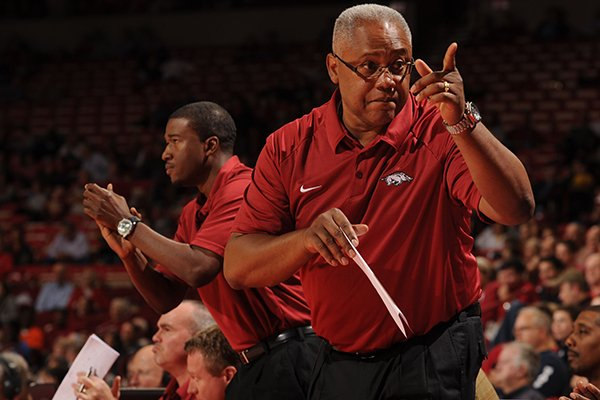 Arkansas associate head coach Melvin Watkins, right, and assistant coach TJ Cleveland, left, direct their team during the second half of play Tuesday, Nov. 5, 2013, in Bud Walton Arena in Fayetteville.