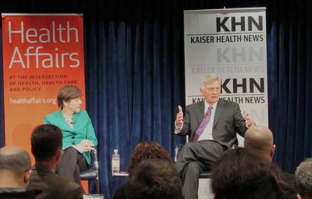 gov-mike-beebe-speaks-with-kaiser-health-news-senior-correspondent-mary-agnes-carey-left-about-arkansas-private-option-plan-to-expand-medicaid-at-a-media-only-forum-at-the-kaiser-family-foundation-in-washington-on-monday-feb-24-2014