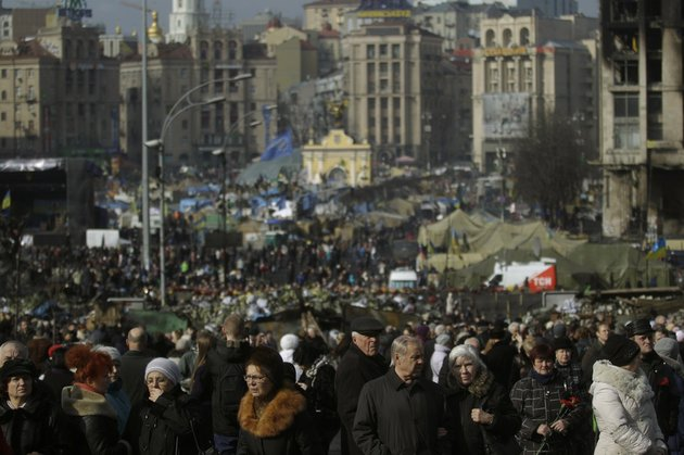 people-flock-to-the-independence-square-in-kiev-ukraine-on-monday-feb-24-2014-ukraines-acting-government-issued-a-warrant-monday-for-the-arrest-of-president-viktor-yanukovych-last-reportedly-seen-in-the-pro-russian-black-sea-peninsula-of-crimea-accusing-him-of-mass-crimes-against-protesters-who-stood-up-for-months-against-his-rule