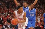 Arkansas guard Anthlon Bell (5) looks to pass out of a trap as Kentucky guard Julius Mays during the second half of play Saturday, March 2, 2013, in Bud Walton Arena in Fayetteville.
