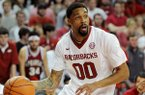Arkansas' Rashad Madden dribbles the ball during the game between Arkansas and LSU on Saturday, Feb. 15, 2014 in Bud Walton Arena in Fayetteville.