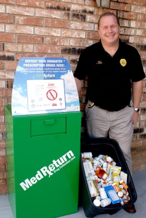 Photo by Dodie Evans Police Chief Andrew Bower with newly installed drug collection unit