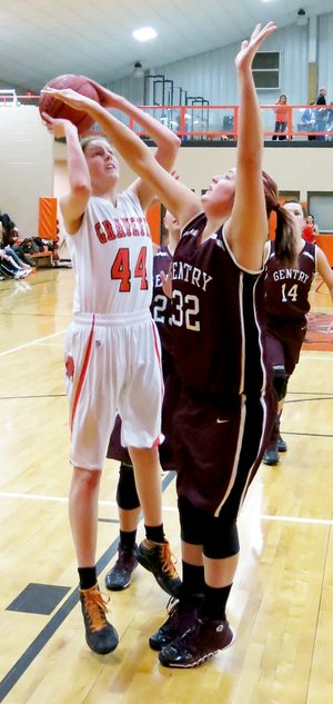 File Photo by Randy Moll Sydney Hicks, Gravette sophomore, attempts a shot while defended by Gentry junior, Meagan Eli, during conference play between the two teams in Gravette.