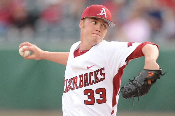 Arkansas starter Trey Killian delivers a pitch Friday, March 15, 2013, during the first inning of play against Ole Miss at Baum Stadium in Fayetteville.
