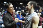 Mississippi's Marshall Henderson (22) greets former Arkansas player Pat Bradley following an NCAA college basketball game against Alabama in Oxford, Miss. on Wednesday, Feb. 26, 2014. (AP Photo/Oxford Eagle, Bruce Newman)