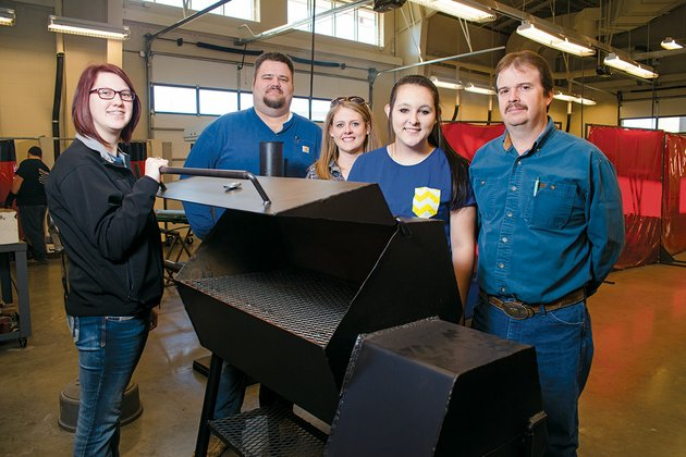 nikki-glass-from-the-left-troy-weatherley-dusty-baxter-bethany-farmer-and-darren-hawkins-are-shown-with-one-of-the-grills-that-will-be-auctioned-off-by-beebe-high-school-ffa-students