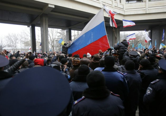 pro-russian-demonstrators-wave-russian-flags-during-a-protest-in-front-of-a-local-government-building-in-simferopol-crimea-ukraine-on-wednesday-feb-26-2014