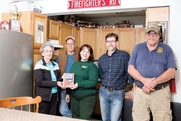 members-of-the-cherry-hill-volunteer-fire-department-from-the-left-sheila-doughty-jarrell-payne-shelby-bull-troy-glenn-and-bernard-bull-show-off-their-new-cookbook-burnt-offerings-silver-anniversary-that-they-have-published-to-help-raise-money-for-the-fire-department