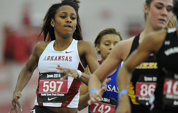 Arkansas runner Brianna Swinton takes the turn as she tries to move up in the pack in the women's 400 meter dash at the Tyson Invitational track meet at the Randal Tyson Track Complex in Fayetteville.