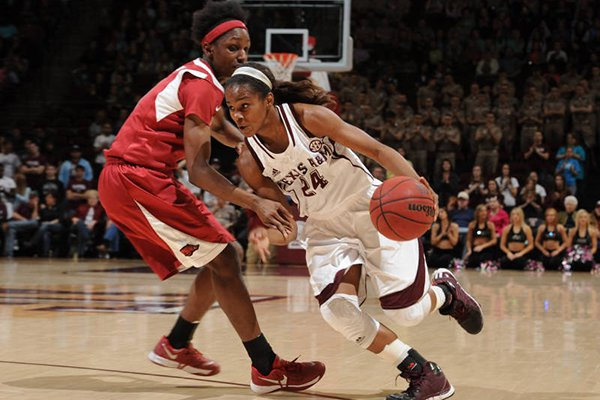 Texas A&M's Jordan Jones drives past Arkansas' Keira Peak on Thursday at Reed Arena in College Station, Texas.