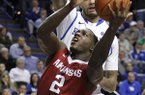 Arkansas' Alandise Harris (2) shoots under pressure from Kentucky's Willie Cauley-Stein during the second half of an NCAA college basketball game, Thursday, Feb. 27, 2014, in Lexington, Ky. Arkansas won 71-67. (AP Photo/James Crisp)