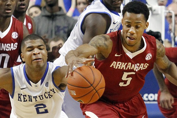 Arkansas' Anthlon Bell (5) and Kentucky's Aaron Harrison (2) chase a loose ball during overtime of an NCAA college basketball game, Thursday, Feb. 27, 2014, in Lexington, Ky. Arkansas won 71-67. (AP Photo/James Crisp)