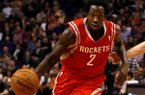 Houston Rockets point guard Patrick Beverley (2) drives against the Phoenix Suns in the first quarter during an NBA basketball game, Sunday, Feb. 23, 2014, in Phoenix. (Rick Scuteri/AP Images)