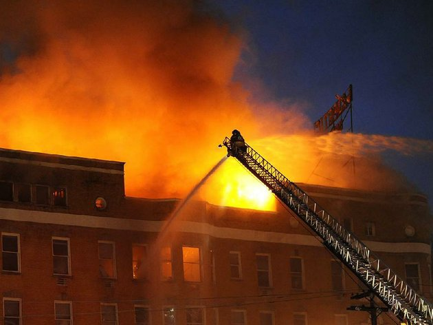 as-the-majestic-hotel-continued-to-burn-after-dark-thursday-fi-refighters-from-lake-hamilton-70-west-and-middleton-volunteer-fire-departments-joined-in-battling-the-flames