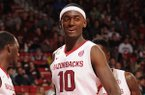 Arkansas freshman Bobby Portis celebrates a basket by Alandise Harris during the second half of play against Alabama Wednesday, Feb. 5, 2014, in Bud Walton Arena in Fayetteville.
