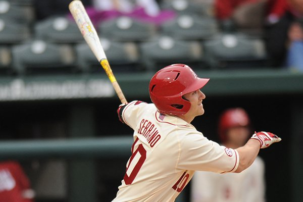 Arkansas left fielder Joe Serrano connects for a 3-run double during the third inning against South Alabama Friday, Feb. 28, 2014, at Baum Stadium in Fayetteville.