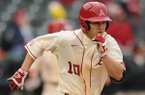 Arkansas left fielder Joe Serrano heads to first after hitting a 3-run double during the third inning against South Alabama Friday, Feb. 28, 2014, at Baum Stadium in Fayetteville.