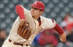 Arkansas starter Jalen Beeks delivers a pitch during the third inning against South Alabama Friday, Feb. 28, 2014, at Baum Stadium in Fayetteville.