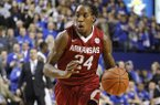 Arkansas' Michael Qualls (24) during the second half of an NCAA college basketball game against Kentucky, Thursday, Feb. 27, 2014, in Lexington, Ky. Arkansas won 71-67. (AP Photo/James Crisp)