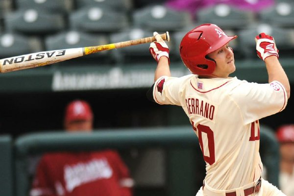 NWA Media/ANDY SHUPE - Arkansas left fielder Joe Serrano connects for a 3-run double during the third inning against South Alabama Friday, Feb. 28, 2014, at Baum Stadium in Fayetteville.