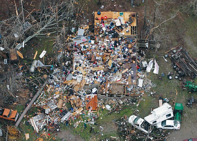 this-photo-shows-whats-left-after-an-april-10-2013-tornado-in-van-buren-county-hit-the-home-of-carolyn-cloud-diles-and-her-husband-ac-on-watergate-road-in-botkinburg-they-were-home-at-the-time-and-cloud-diles-was-injured-she-said-a-double-billboard-blew-into-their-yard-as-well-as-metal-from-a-barn-miles-away-and-other-debris-some-of-the-couples-family-photos-were-found-10-miles-away-and-returned-she-said