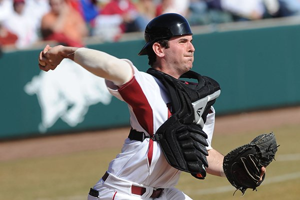 Arkansas catcher Jake Wise throws to second base.