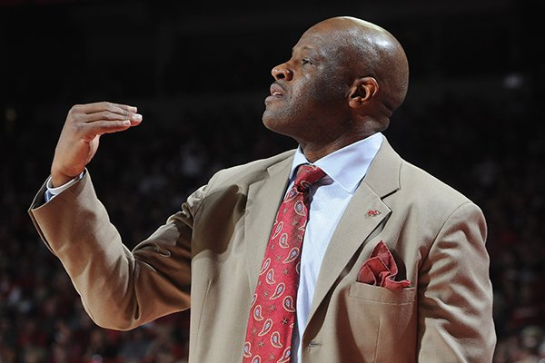 Arkansas' Mike Anderson coaches from the bench Saturday, March 1, 2014, during the second half of the game at Bud Walton Arena in Fayetteville.