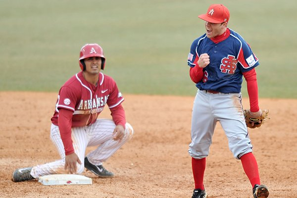 Arkansas baserunner Michael Bernal is forced out at second base by South Alabama short stop Drew LaBounty in the 4th inning of the first game of Saturday's doubleheader at Baum Stadium in Fayetteville.