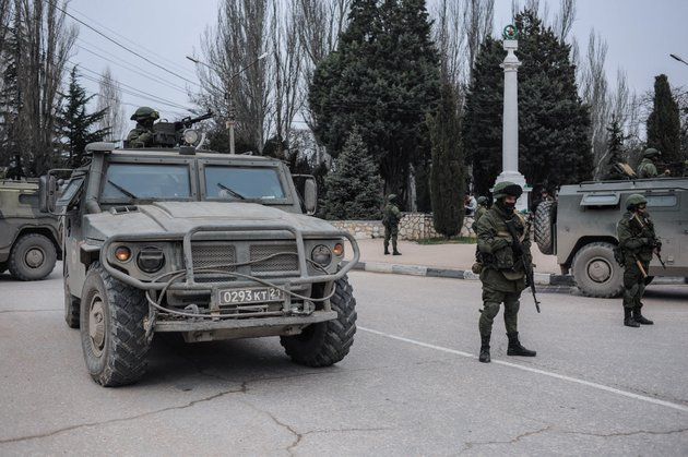 troops-in-unmarked-uniforms-stand-guard-in-balaklava-on-the-outskirts-of-sevastopol-ukraine-saturday-march-1-2014-an-emblem-on-one-of-the-vehicles-and-their-number-plates-identify-them-as-belonging-to-the-russian-military