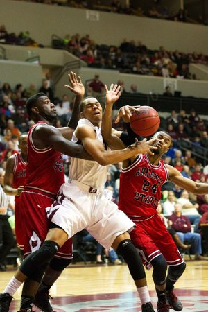 Special to the Arkansas Democrat Gazette/CHRIS BRASHERS - 03/01/2014 - UALR forward Mareik Isom battles a pack of ASU Red Wolves at the Jack Stephens Center in Little Rock, March 1, 2014