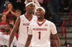 Arkansas players Mardracus Wade and Bobby Portis react after a South Carolina turnover late in the second half of a Feb. 19, 2013 game at Bud Walton Arena in Fayetteville.