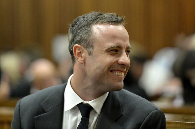 oscar-pistorius-smiles-in-court-during-his-trial-at-the-high-court-in-pretoria-south-africa-on-monday-march-3-2014-pistorius-is-charged-with-murder-with-premeditation-in-the-shooting-death-of-girlfriend-reeva-steenkamp-in-the-predawn-hours-of-valentines-day-2013