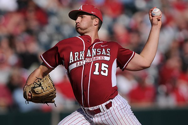 Colin Poche pitches for Arkansas during the game against Eastern Illinois at Baum Stadium in Fayetteville on Saturday, Feb. 22, 2014.