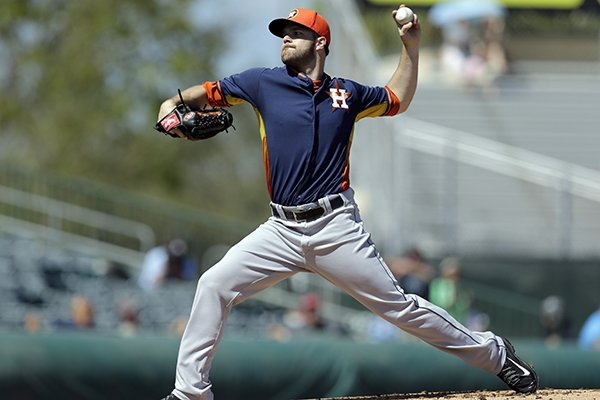 Houston Astros starting pitcher Dallas Keuchel throws during the first inning of an exhibition spring training baseball game against the Miami Marlins Monday, March 3, 2014, in Jupiter, Fla. (AP Photo/Jeff Roberson)