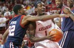 Arkansas sophomore Mardracus Wade works around Ole Miss freshman Jarvis Summers to the basket during the first half at Bud Walton Arena in Fayetteville on Tuesday, Feb. 28, 2012.