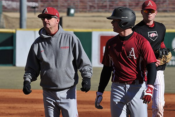 Arkansas coach Dave Van Horn works with the Razorbacks during the first practice of the season Friday, Jan. 24, 2014 at Baum Stadium in Fayetteville.