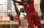 Arkansas Democrat-Gazette/RICK MCFARLAND --01/28/14--  Parkview's Daryl Macon (4) shoots over Hall's Robert Verges at Hall HS gym in Little Rock Tuesday night.