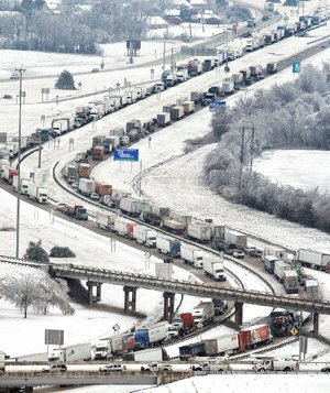 Traffic backs up in all directions Tuesday on Interstate 40 at West Memphis, one of several snarled spots on I-40 and Interstate 55 in eastern Arkansas.