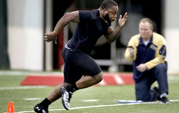 Kiero Small runs the 40 yard dash Wednesday March 5, 2014 during the 2014 Pro Day at the Walker Family Training Center on the campus of the University of Arkansas in Fayetteville.