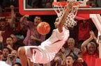 Arkansas forward Coty Clarke dunks the ball on a fast break during a 2014 game against Ole Miss at Bud Walton Arena in Fayetteville.