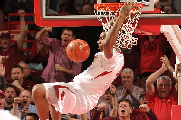 Arkansas forward Coty Clarke dunks the ball on a fast break during Wednesday night's game against Ole Miss at Bud Walton Arena in Fayetteville.